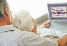 Older Couple Looking at Computer Screen and Link to Cremation Services
